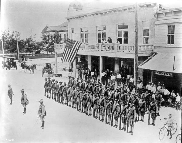 Members of the Florida Militia in formation on Flagler Street - Miami, Florida