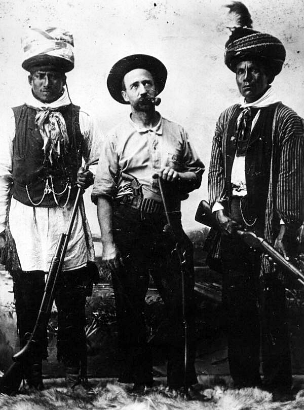 Two indians and a cowboy
