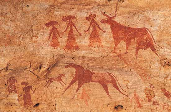 Cave painting representing women floating with the products of a recent hunt.